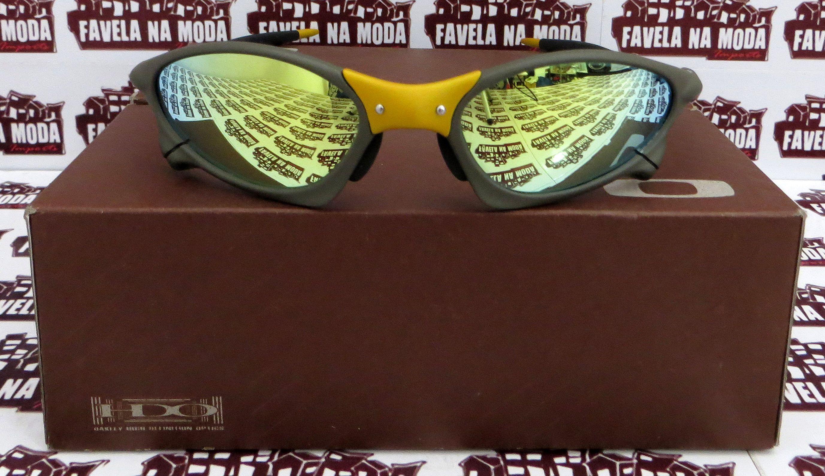 Óculos Oakley Penny - 24k   Gold   Borrachas Pretas 05234f7dca