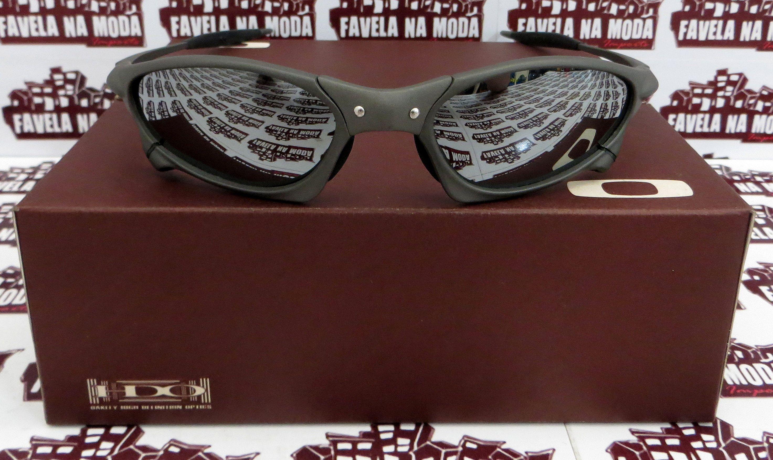 18053391cea20 Óculos Oakley Penny - X-Metal   Liquid Metal   Borrachas Pretas